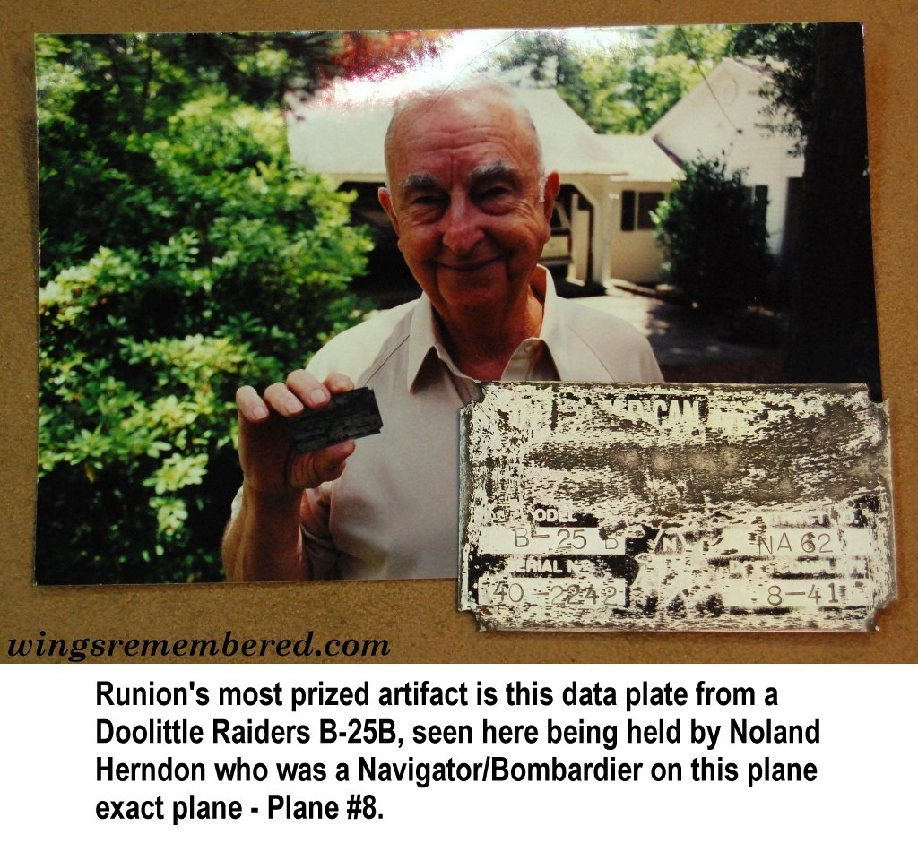 Noland Herndon holding data plate from plane caption