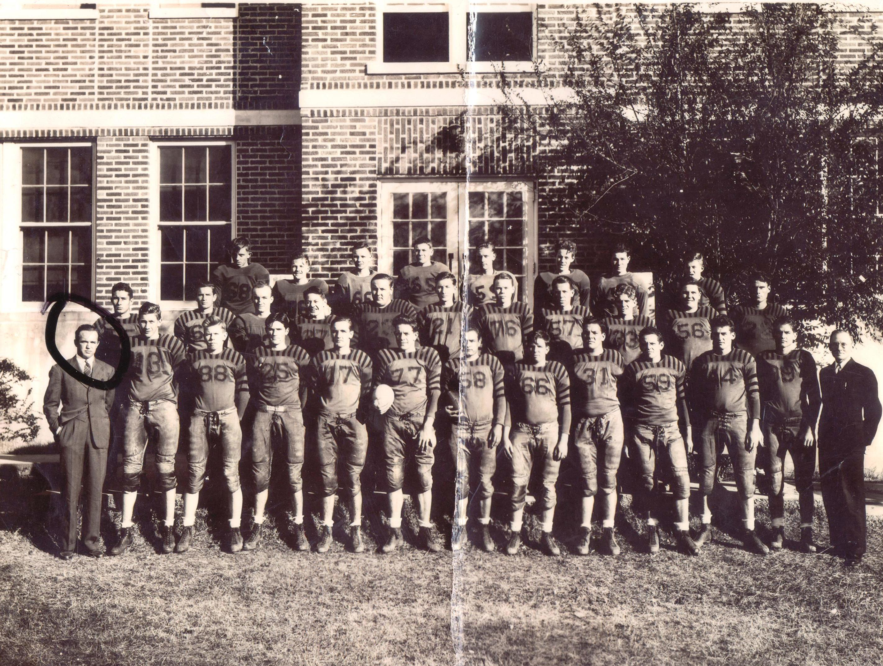 Coach Bill with the Starkville High School Football team